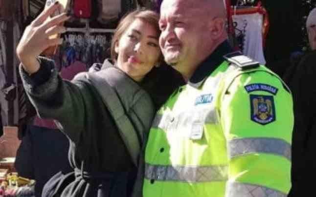 """Polițistul care a ajutat-o pe Oana Lovin """"Sparanghel"""" să ajungă la racla Sfintei Parascheva ar putea să își piardă locul de muncă"""