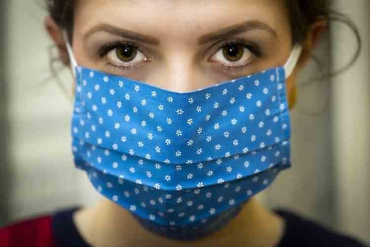 Carantina ar putea fi evitată dacă majoritatea oamenilor ar purta mască - Recomandările OMS