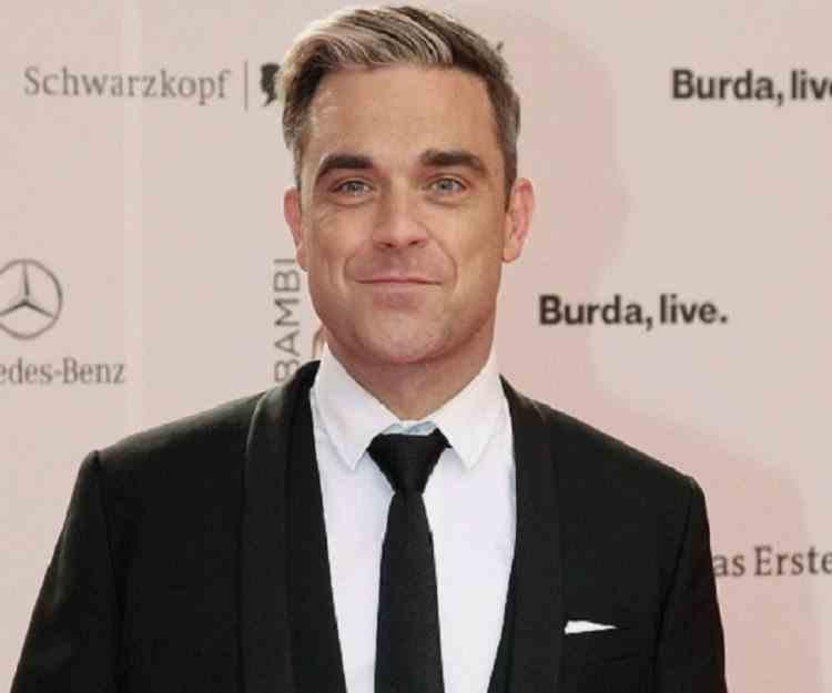 Robbie Williams a fost la un pas de moarte după ce s-a otrăvit cu mercur