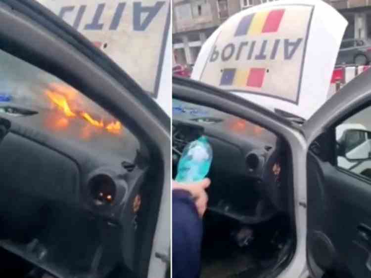 O autospecială de poliție a luat foc în București - Agenții au încercat să stingă incendiul cu o sticlă cu apă de 0,5 L